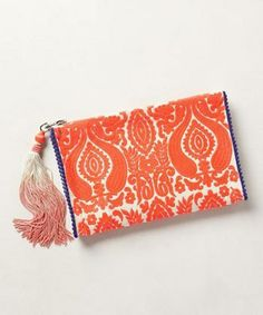 We're loving the embroidery on this clutch from Anthropologie!  - super cute clutch/tribal inspired