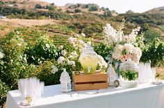 Water Station = Really Like this Idea! Would style it to fit the wedding theme and maybe add classy personalized water bottles.