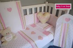 Hearts theme cot set in pink & gold.