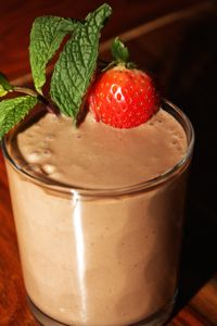 Chocolate Banana Peanut Butter Smoothie from The Biggest Loser Serves: 4 (12 ounce glass) 4 cups Ice 2 bananas 1/4 cup peanut butter 1 cup low fat Greek-style yogurt 1 Tablespoon honey 1 cup chocolate almond milk, unsweetened 4 scoops vanilla whey protein powder 209 CAL