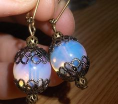 Moonstone earrings with antique brass filigree  - Vintage inspired moonstone jewelry. $19.95, via Etsy.