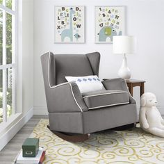 The classic design of the wingback chair is the inspiration for the beautiful Baby Relax Hudson Wingback Rocker. With modern touches such as the contrasting white welt details on the sides and seat cu