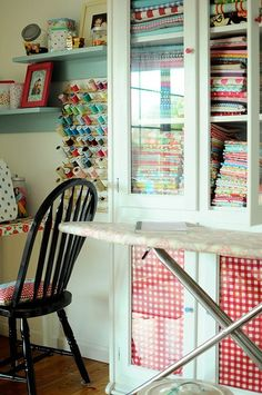 sewing room. I like the glass cabinet idea. Keeps dust etc off your fabrics yet you can still see them.
