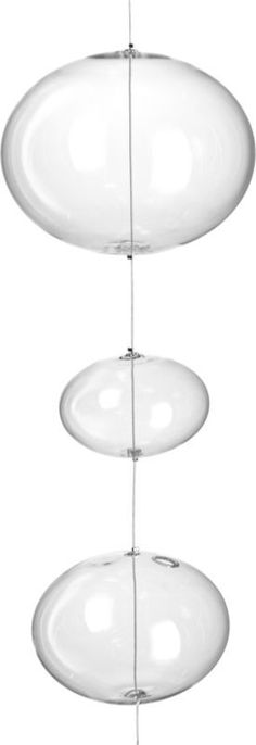 Shop hanging 21 orbs strand.   Handmade glass spheres suspend light as air party vibe.  Single strand of 21 freeform bubbles is threaded with fishing wire to hang easy overhead.  Fun in multiples. Learn how to hang a dazzling glass display on .
