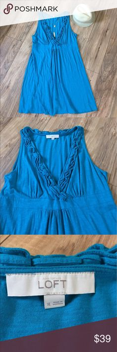 """LOFT aqua sleeveless dress with ruffle neckline Ann Taylor LOFT sleeveless ruffle trimmed dress in a beautiful deep aqua color. Super soft - 60% cotton / 40% modal. There is some stretch to this dress. I am 5'5"""" and a 38dd and the skirt hits me right below the knee and is true to size. Machine wash. Worn 2x - EUC! LOFT Dresses Midi"""