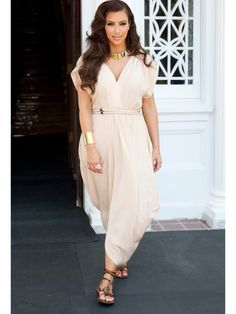 Kim Kardashian Style Trick: Grecian is Always GoodShe's a modern day goddess, and this Athenian-chic outfit worn to a photo shoot proves it. True to form, Kim nails the details, too: a rope belt, wide gold cuff and flat gladiator sandals. Photo Credit: Courtesy iVillage via StyleList