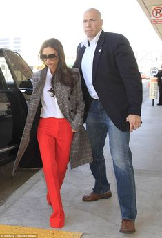 Hard to miss! Victoria Beckham turned heads with her vibrant trousers when she caught a flight out of LAX on Monday