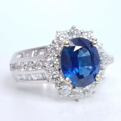 18K White Gold Sapphire: 3.05ct Diamonds: Round Cut and Baguette Cuts 1.45cts Quality: F-G color, VS-SI clarity