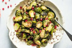 Roasted Brussels sprouts tossed with an easy pomegranate-balsamic glaze. Simple, festive side dish for Thanksgiving or any holiday meal.