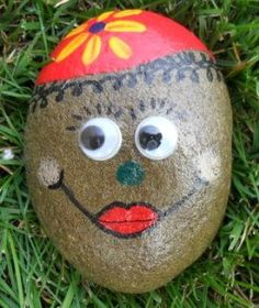 Rock Hand Painted with a Flower Hat and Jiggly Eyes Paper Weight Pet Rock Garden Decor via Etsy