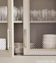 Relaxed and Refined Stainless steel mesh cabinet faces show off dishware. - Kitchens: Relaxed and Refined - Traditional Home®Stainless steel mesh cabinet faces show off dishware. - Kitchens: Relaxed and Refined - Traditional Home® Kitchen Cabinets Upgrade, Kitchen Cabinetry, Pantry Cabinets, Kitchen Refacing, Corner Cabinets, Storage Cabinets, Ideas Cabaña, Door Ideas, Cabinet Refacing