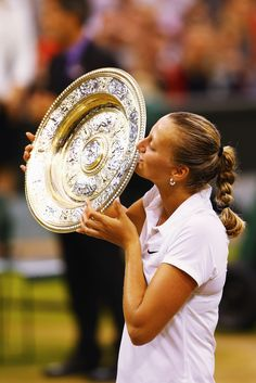 Petra Kvitova of Czech Republic poses with the Venus Rosewater Dish trophy after her victory in the Ladies' Singles final match against Eugenie Bouchard of Canada on day twelve of the Wimbledon Lawn Tennis Championships at the All England Lawn Tennis and Croquet Club on July 5, 2014 in London, England. (Photo by Al Bello/Getty Images)