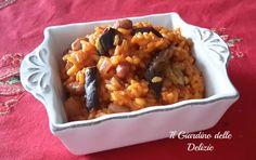 Il risotto melanzana e pomodoro con fagioli è un corposo primo piatto, caldo ed adatto a questa stagione, riempitivo e gustoso