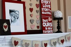 fabulous Vday mantel...love the hanging hearts in empty frame.