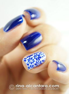 Manicure Monday: blue mani with floral accent nail.