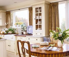 Add warmth with wood. A mix of wood species, including painted and antique furniture pieces, enriches visual texture.