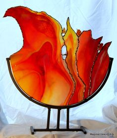 "Sometimes a sheet of glass demands to be used…this one was shouting ""fire"" in a crowded room (my studio). I was inspired by the flow of the"