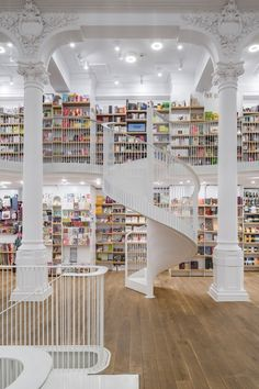 This is a bookshop in Bucharest! - - This is a bookshop in Bucharest! This is a bookshop in Bucharest! This is a bookshop in Bucharest! Beautiful Library, Dream Library, Libreria El Ateneo, One Photo, Home Libraries, Interior Design Magazine, Book Nooks, Retail Design, Future House