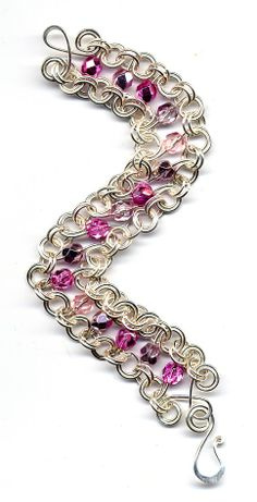 S link bracelet - love how beads are on their own spiral links joined by matching rings: very beautiful :)