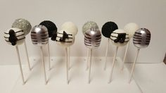 Music theme sanding sugar, silver microphone and cakepops with music symbol.