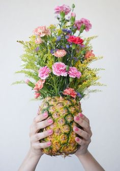 Not a fan of those spiky pineapple leaves? Chop them off and carve out the fruit of your pineapples. Then put your floral centerpieces directly into that lovely pineapple. You get a pretty flower arrangement and delicious fruit to snack on. It's the best of both worlds!  Image found on Clo by Clau