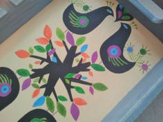 Wooden tray painted by hand.