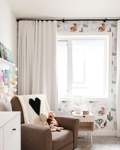 A whole llama love in Hey Sarah Darling's boho chic baby nursery design that fits her style and home perfectly. A sweet and bold graphic wallpaper with floor-to-ceiling blackout draperies were a great way to up the design game in this sweet space. Help your little one get a better night's sleep with custom window treatments from Budget Blinds. Budget Blinds, Graphic Wallpaper, Custom Window Treatments, Chic Baby, Blackout Windows, Nursery Design, Good Night Sleep, Drapery, Boho Chic