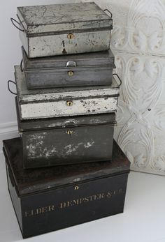 Metal storage bins make a great end table when stacked and you can store throw blankets and magazines in them as well.