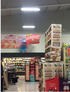 Strategically hang ceiling signs using The Clik-Clik Magnetic Hanging System Beam Ceilings, Ceiling Beams, Retail Stores, Ceiling Decor, Hanging Signs, Magnets, Drop, Snacks, Appetizers