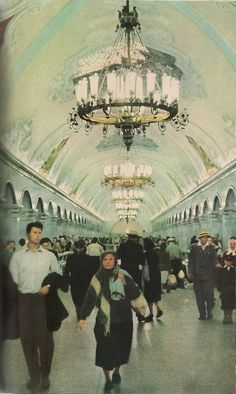 December, 1959  Brilliant chandeliers light an undergroud palace in Moscow's subway.  Each of the city's 46 subway stations differ in architectural motif; the decor stresses Soviet achievements. Construction in the 1930's enlisted the country's best planners and artists, and thousands of labourers. Corridors and landings house statues, murals, and gem-studded mosaics glorifying Russian leaders, soldiers, and workers. Some street-level entrances esemble classic temples.