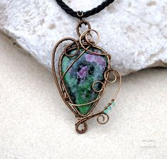 Ruby Zoisite wire wrapped pendant by IanirasArtifacts on DeviantArt