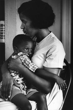 Fifty years ago: Myrlie Evers holds her son Van, shortly after her husband Medgar was murdered, 1963. She had just turned thirty and they had three children. © Flip Schulke