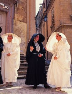 The għonnella (pl. għonnielen), sometimes referred to as a Faldetta, was a form of women's head dress and shawl, or hooded cloak, unique to the Mediterranean islands of Malta and Gozo