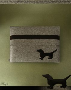 macbook air sleeve with leather doggy. Maybe I can make something similar for a purse or something lol :)