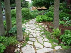 A spaced flagstone path gives your outdoor scene a rustic and natural look. Line the path with small decorative stones to increase the feeling of being in a forest.