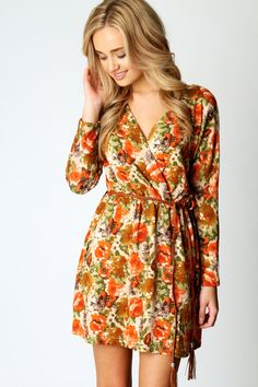 Colors are so bright and the dress is creative.Mary Brushed Knit Floral Belted Wrap Dress