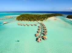 Le Taha'a Island Resort & Spa, Taha'a, French Polynesia. 10 mins from Bora Bora by helicopter. Guests stay in overwater bungalows or beach villas built w/ local bamboo; former have wrap around decks, so guests can kayak to/from their rooms; villas have plunge pools and hammocks under coconut trees. Meals can be delivered on the beach. Activities include swimming with sharks.