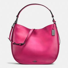 Coach Nomad Hobo ($495) ❤ liked on Polyvore featuring bags, handbags, shoulder bags, pink leather purse, leather hobo handbags, coach shoulder bag, leather cross body purse and hobo shoulder bags
