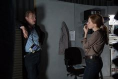 Director Christopher Nolan and Jessica Chastain on the set of Interstellar (2014).