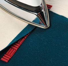 Create iron-friendly pressing guides using recycled potholders.
