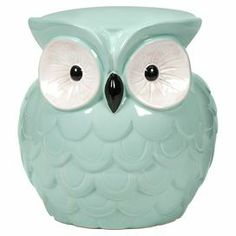 """Perfect as extra guest seating in your three-season porch or for stowing books and magazines in the den, this charming garden stool showcases an owl silhouette and aqua glaze finish.  Product: StoolConstruction Material: 100% CeramicColor: Aqua, white and blackDimensions: 13"""" H x 12.5"""" W x 13"""" D"""