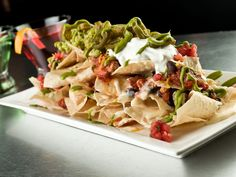 Atlanta Falcons: Fried Chicken Nachos : Among the culinary goodies offered at Georgia Dome are foot-long hot dogs and the peach state's peach cobbler. While it's not the Dome, STATS, a local favorite bar and grill, serves up Sweet Heat Fried Chicken Nachos that win the day with Falcons fans. The game-time favorite, often consumed by the pile in the parking lot at tailgates, is a messy must-have made with buttermilk fried chicken tenders, sweet heat peach BBQ sauce and spicy Jack cheese…