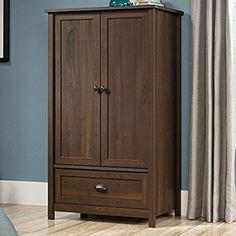 Offering up both extra clothing storage and classic design, the Sauder County Line Armoire is a must-have for most any bedroom. Commercial Office Furniture, Nebraska Furniture Mart, Furniture Manufacturers, Beautiful Bedrooms, Adjustable Shelving, Interior Design Living Room, Home Furnishings, Armoire, Tall Cabinet Storage