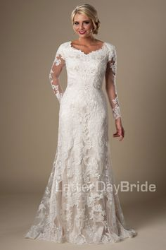 Caymbria | Modest lace wedding dress | LatterDayBride & Prom | LDS bridal gown | SLC | Utah bridal shop | Worldwide Shipping | Visually stunning floral lace softly makes its way from long sleeves all the way down to the train. Tulle and Luxe silky charmeuse lining, and is accented with a button closure.    Gown available in Ivory, White or Champagne/Ivory    *Gown pictured in Champagne/Ivory    Sleeve length or neckline can be customized.