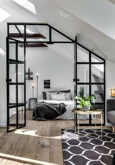 Scandinavian decoration and ideas. Livingroom and bedroom with glass wall divider.