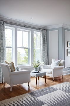 Home Decor and Lifestyle from Hello Lovely Studio: Beautiful seating area with armchairs in front of window in blue master bedroom designed by Sarah Richardson