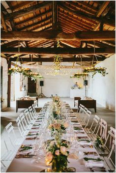Rustic wedding reception setting  / © James & Lianne Photography