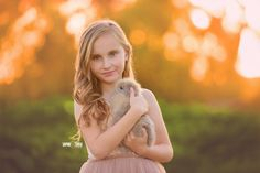 Child holding a live bunny for photography mini session in San Diego, CA