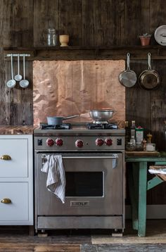 Copper backsplash kitchen range stove