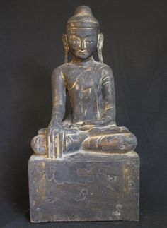 Antique Burmese Buddha [Material: Wood] [59 cm high] [19th century] [Shan (Tai Yai) style] [Bhumisparsha Mudra] [Partly goldplated with 24 krt. gold] [Originating from Burma] [Price: 750 euro]